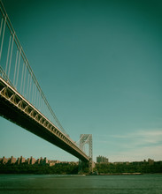 Low Angle View Of George Washington Bridge Over Hudson River Against Sky