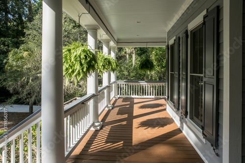 Wrap around porch on beautiful luxury home. Canvas