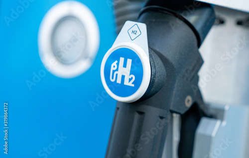 mata magnetyczna hydrogen logo on gas station. h2 combustion engine for emission free ecofriendly transport.