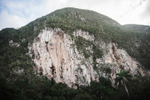 A Rock Face In The Mountains O...