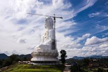 Buddha Statue Against Sky At Wat Huai Pla Kung