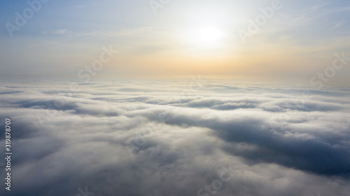 Obraz Yellow and blue dawn over clouds, concept, travel and leisure. - fototapety do salonu