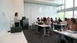 Lecturer presenting to university students in classroom