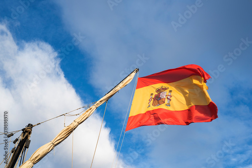 Spanish flag flying above old pirate ship in port of Torrevieja, Alicante, Spain Wallpaper Mural