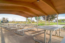Eating Area At A Park With Tab...