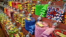 Colorful Candies In Racks For ...