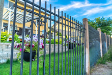 Black Metal Fence With Potted ...