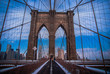 Low Angle View Of Brooklyn Bridge Against Blue Sky In City
