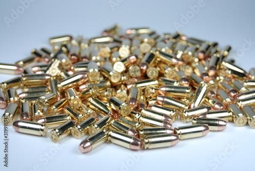 Fototapeta Close-Up Of Ammunitions On Table