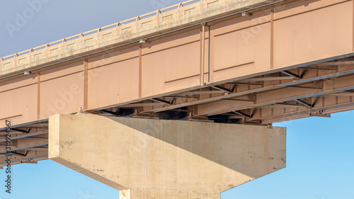 Photo Panorama View beneath a stringer bridge with massive abutment that supports the
