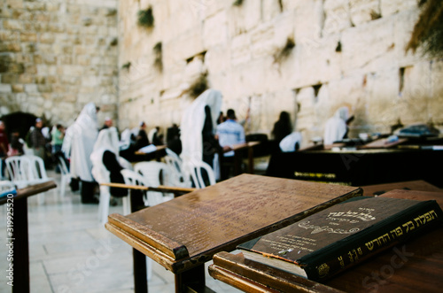 Torah On Table With People Standing By Wailing Wall Wallpaper Mural
