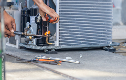 Close up of Air Conditioning Repair team use fuel gases and oxygen to weld or cu Canvas Print