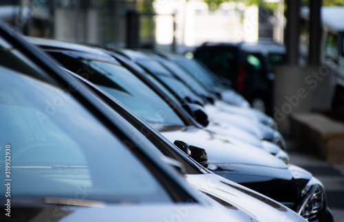 Obraz Cars Parked In Row On Street - fototapety do salonu
