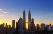Low Angle View Of Petronas Towers And Cityscape And Against Sky During Sunset
