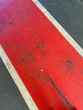 High Angle View Of Red Marking On Road
