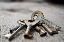 Close-Up Of Rusty Keys On Table
