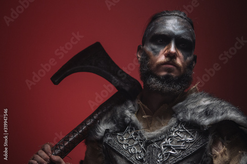 The Viking stands in a fighting position, pointing the battle axe towards the camera Canvas Print