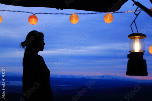 A clean woman's profile silhouette with a sweet lantern and ball lights against the background of fantastic colorful gradation sky Canvas Print