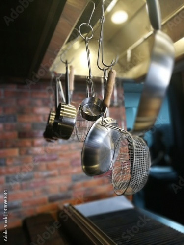 Fototapeta Utensils Hanging In Kitchen obraz na płótnie