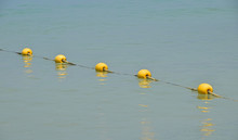 Yellow Buoy With Rope Floating...
