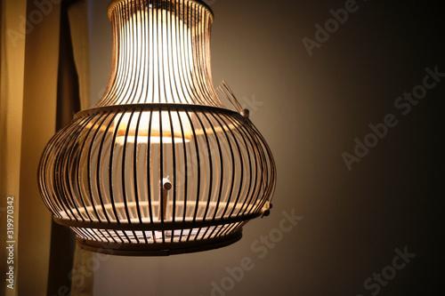 Photo A shot of a light inside of an old birdcage fixture.