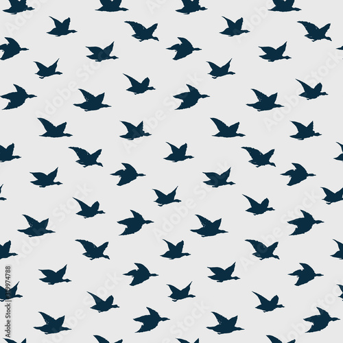 obraz lub plakat Spring Swallow Birds Simple Print. Seamless Pattern with Birds Silhouettes for fabrics textile print design, wallpapers. Dark Blue Elegant flying crabe birds isolated on grey background