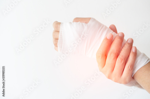 Women with painful wrist due to overuse or sport accidental on white background, Wallpaper Mural