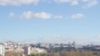 Cable car over casa de campo park and Madrid skyline on the Background.