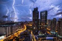 Lightning Strike Against Illuminated Buildings