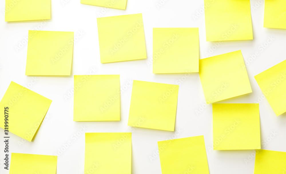 Fototapeta reminder yellow notes on white background