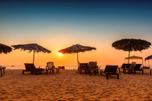 Sun Umbrellas With Lounge Chairs At Sunset On A Tropical Sunny Beach In GOA, India