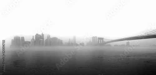Valokuvatapetti Brooklyn Bridge Over East River In Foggy Weather