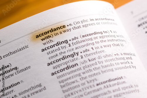 Photo The word or phrase Accordance in a dictionary.