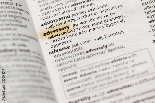 Photo The word or phrase Adversary in a dictionary.