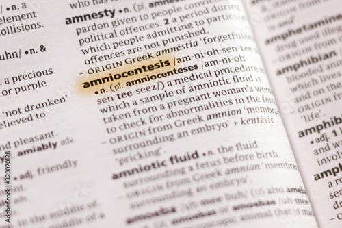 The word or phrase Amniocentesis in a dictionary. Wallpaper Mural