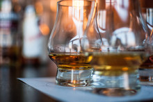 Close-Up Of Scotch Whiskey Glasses On Table