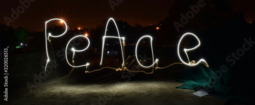 Obraz Peace Text Made From Light Painting At Night - fototapety do salonu