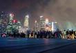 People On Road Against Illuminated Buildings