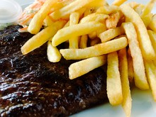 Close-up Of French Fries And Steak