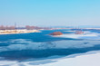 idyllic winter scenery with melting ice on the river