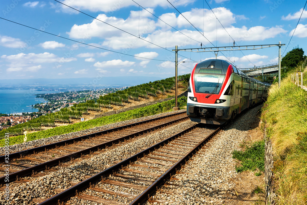 Fototapeta Train at Vineyard Terrace of Lavaux at Lake Geneva and Swiss Alps, Lavaux-Oron district, Switzerland