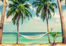 Beautiful Beach.  Hammock Between Two Palm Trees On The Beach. View Of Nice Tropical Beach With Palms Around. Holiday And Vacation Concept.  Tropical Beach. Beautiful Tropical Island In Thailand.