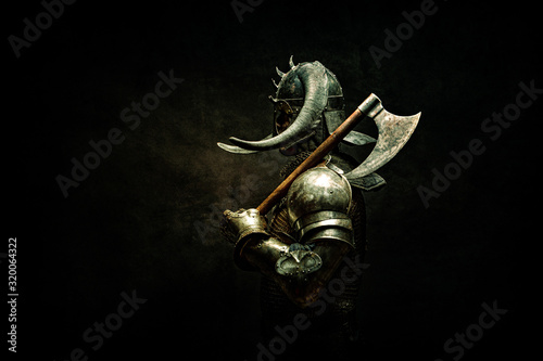 Portrait of a Viking Berserker warrior, holding an ax on his shoulder Canvas Print