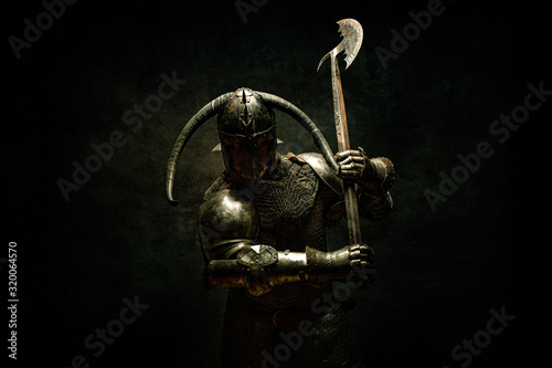 Photo Portrait of a Viking Berserker warrior, holding a halberd in his hands