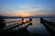Sunset or sunrise over reservoil and pump station for water consmer supply