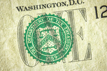 Dollar Bill Close Up. Detail Of US One Dollar Banknote With Green Seal Symbol. Macro View Of Single Dollar Bill.