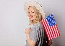 Beautiful Blonde Woman In Cowboy Hat With USA Flag On White Background