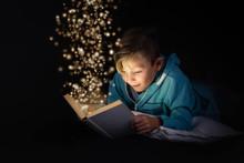 Blond Boy Reading A Magicical ...