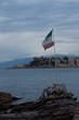 Italian Flag At Beach Against Sky