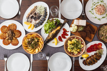 Large Wooden Table With Mouthwatering National Russian Dishes. The Restaurant Where The Food Is Cooked Is As Satisfying And Delicious As Home, Top View